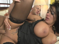 Dark haired hoe with a strap-on fucks her freaky partner so hard