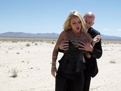 Alluring blonde gets seduced by agent in the hot desert