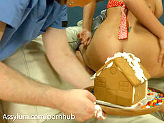 Ass whore expels whipped cream from butt onto gingerbread mansion and gobbles it