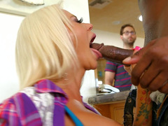 A huge black fella is fucking a hot soccer mom in front of her boyfriend