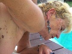 Nasty aged blonde that loves cock is getting fucked by the pool