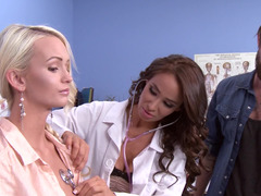 Blonde is getting analyzed by a brunette doctor in the office