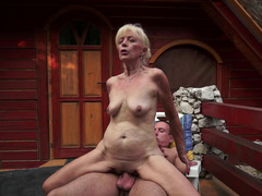 Blonde that loves purple pole is bringing her mature body over a dude today