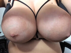 Busty babe ties up her giant boobs with big nipples
