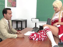 A lovely blonde is climbing on the desk and she is rammed hard