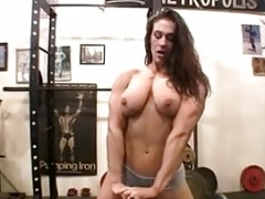 Undressed Female Bodybuilder Poses in the Gym