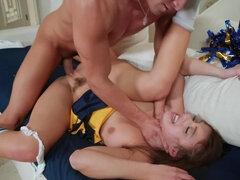 Long-haired brunette cheerleader gets banged by older lover