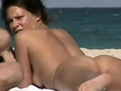 Hot naked females filmed on a nudist beach