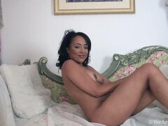Kayla Louise strips naked by her floral chair