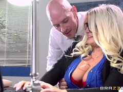 Full-breasted secretary Julie pleases her boss on the desk