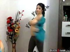 dancing brunette showing her big tits feature