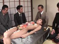 Business dudes eat sushi out of a naked girl's body
