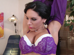 A black haired slut removes her bra and then she rides a purple rod