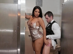 Gorgeous busty brunette gets fucked in the bathroom stall