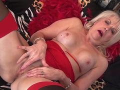 This breasty granny in sexy lingerie is jacking off on the bed while on live camera