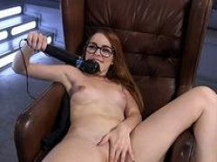 Long haired redhead having an intercourse machine