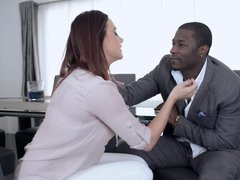 A black dude has his way with a chick from office on the desk
