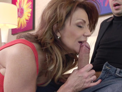 A brunette mature lady is opening up her pussy so she could get fucked