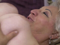 Lusty granny Astrid moans with each thrust of young throbbing cock
