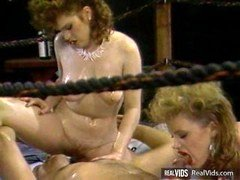 Oiled wrestling babes with sizeable jugs gets screwed hard by coach in hot three-way