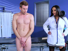 A sexy milf with large fake tits is fucking her patient