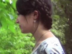 Oriental teen pees outdoors