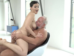 Short-haired Yasmeena gives Albert her feet for caressing