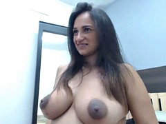 latin slut showing big tits and dark nipples freely on cam