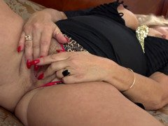 A hot granny is by herself, playing with her sensitive cunt