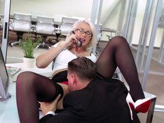 A blonde secretary is getting her tight clit licking and entered