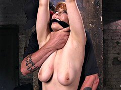 Sexy redhead gets kilted up and moreover humiliated with a dildo