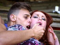 A redhead is tasting a huge thick pole with her pierced pussy
