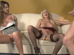 Lucky guy bangs two cock hungry ladies on the couch