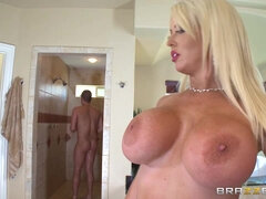 Dude drags his busty blonde lover into the hot shower