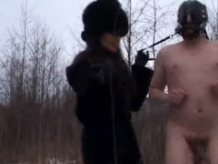 Goddess ballbusting and rides her masked pony slave outdoors