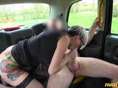 Fake Taxi (FakeHub): Tattooed MILF drains cabbies balls