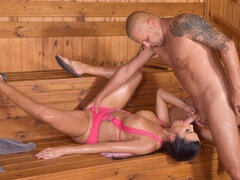 Sex-loving busty brunette Ania Kinski gives a sloppy blowjob in the sauna