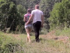 This romantic couple is having hardcore sex in nature