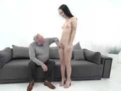 Black haired nymph fucking old man on the couch