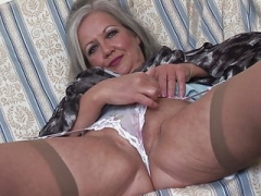 Bigtitted grown-up babe April upskirt and striptease show