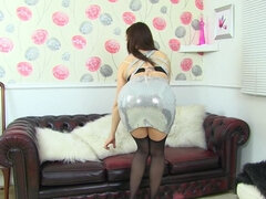 British housewife Kitty Cream playing with herself