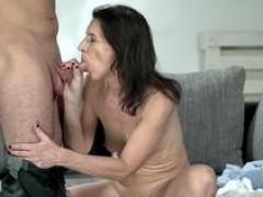 Flag pole riding mature woman