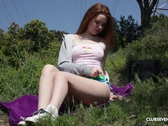 Redhead playing with her pussy outside