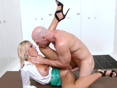 Stud and a slut in a miniskirt fucking in the showers