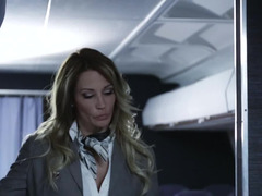 A blonde is in the plane and she watching a couple fucking