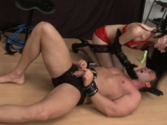 Rectal toying female domme gives man foot job