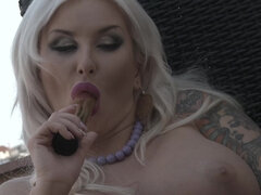 Stunning blonde MILF in fishnets wants to toy her vagina