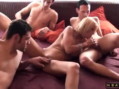 Big breasted German slut gets nailed rough by three guys